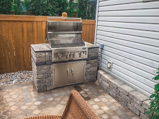 Custom BBQ Pit and Patio Designed by Lucid Landscapes in Edmonton